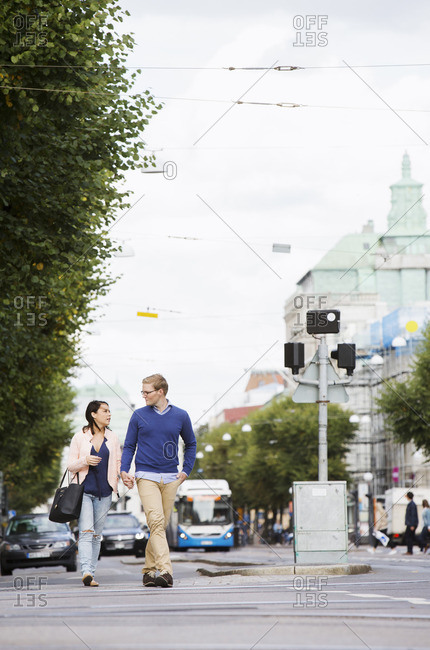 Sweden, Vastergotland, Gothenburg, Young couple walking in street