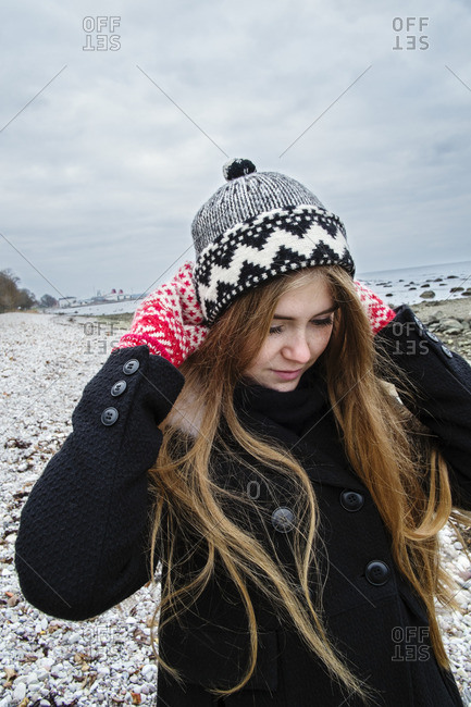 Sweden, Gotland, Blonde young woman with long hair in woolly hat