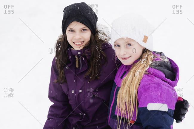Sweden, Vastmanland, Portrait of girls in warm clothing