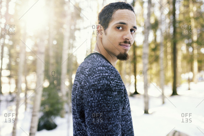Sweden, Vasterbotten, Umea, Portrait of man in winter forest