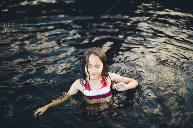 Sweden, Girl in swimming costume standing in water