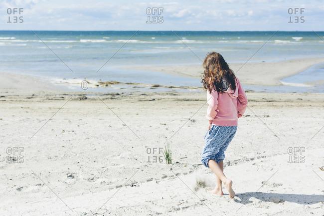 Sweden, Oland, Kopingsvik, Rear view of girl (10 -11) on sandy beach