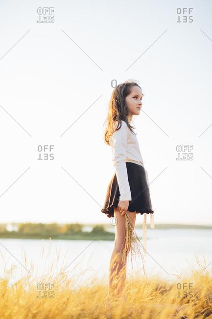 Sweden, Blekinge, Karlskrona, Girl standing in field