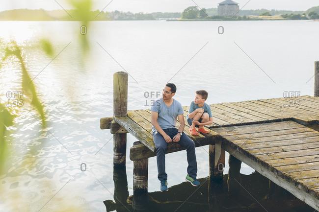 Sweden, Blekinge, Karlskrona, Father and son by lake