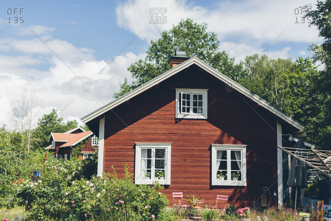 Sweden, Smaland, Mortfors, Farbo, Red house on sunny day