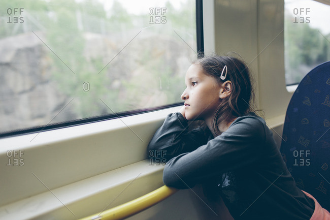 Sweden, Girl sitting in train