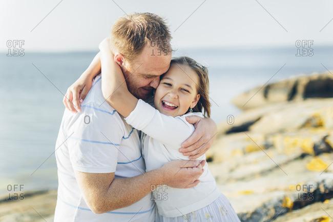 Sweden, Blekinge, Man hugging girl