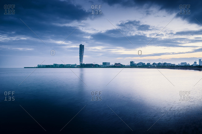 Sweden, Oresund Region, Skane, Malmo, Vastra hamnen waterfront with Turning Torso towering over city