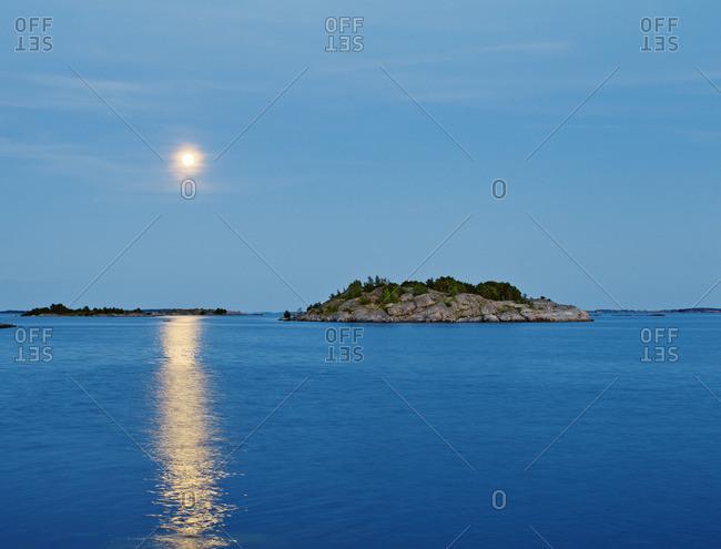 Finland, Eckero, Berghamn, Moonlight over Aland Archipelago