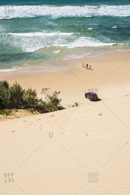 Australia, Queensland,  - April 16, 2015: Great Sandy National Park, Rainbow Beach, Sandy beach with car and people