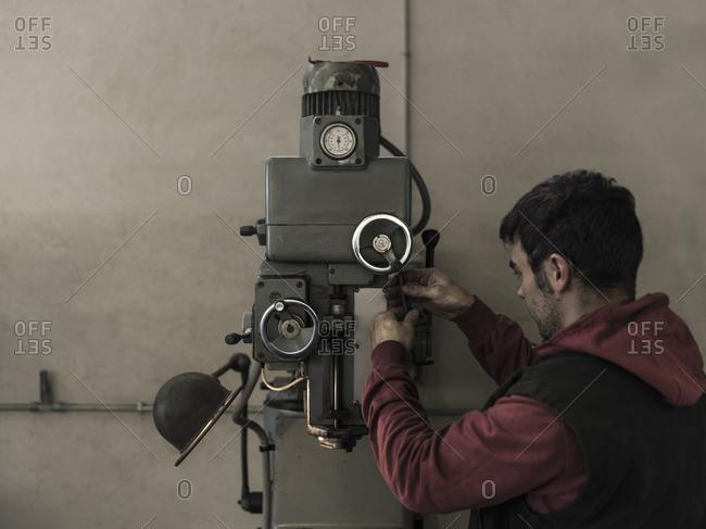France, Man working in workshop