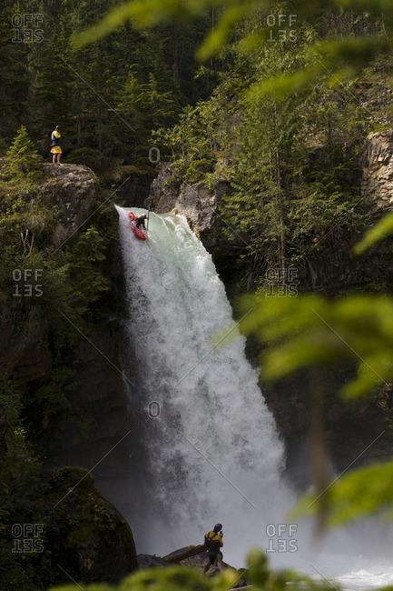 A kayaker running the 60 foot Sutherland Falls, Revelstoke, British Columbia, Canada