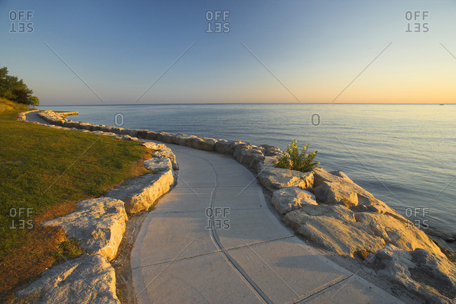 Stone path along the shore of Lake Ontario at sunrise, Niagara-on-the-Lake, Ontario, Canada