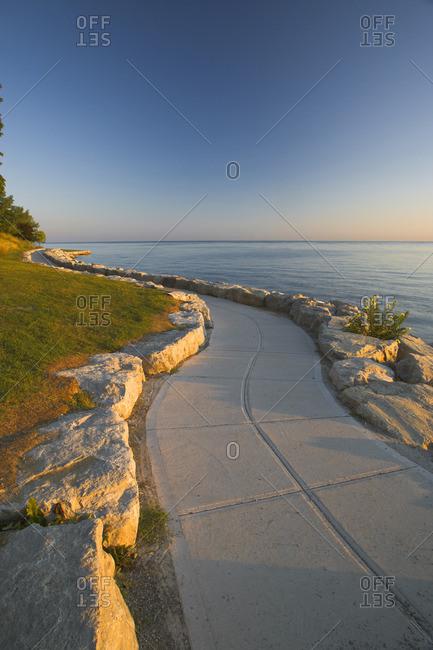Stone path along the shore of Lake Ontario at sunrise, Niagara-on-the-Lake, Ontario, Canada