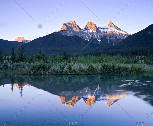 Three Sisters Mountain reflection in water, Canmore, Alberta, Canada