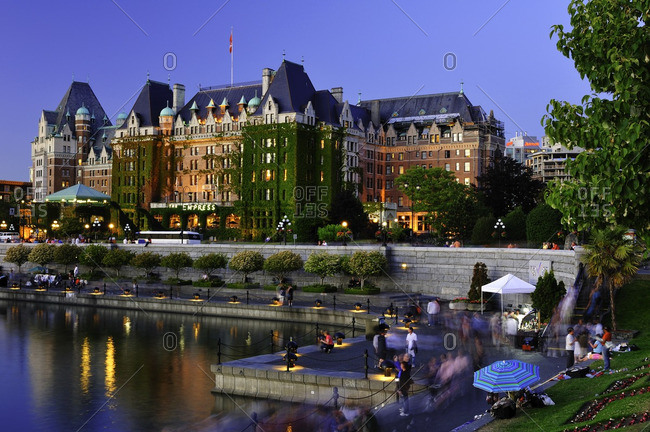 British Columbia, Canada - June 27, 2008: Empress Hotel at dusk with waterfront causeway activity, Victoria, Vancouver Island, British Columbia, Canada