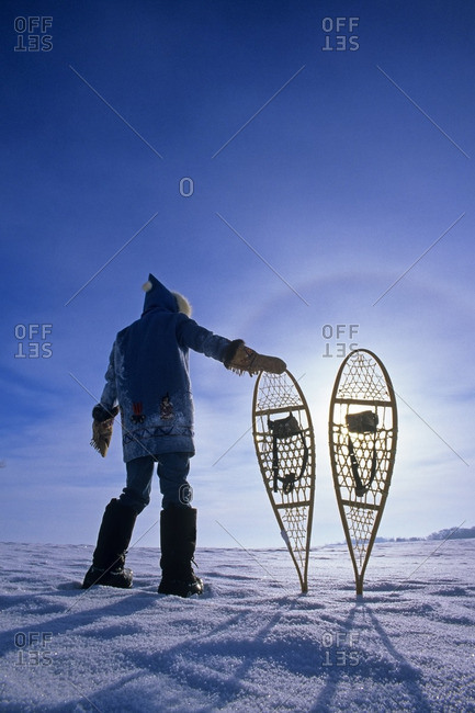 man with snowshoes, near Dugald, Manitoba, Canada
