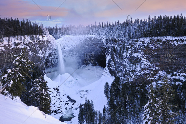 Helmcken Falls in winter with accumulated snow ice cone, Wells Gray Provincial Park, British Columbia, Canada