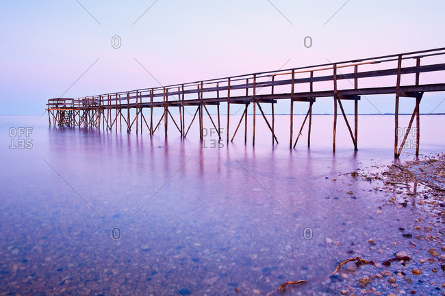 Wooden Pier on Lake Winnipeg at dusk.  Matlock, Manitoba, Canada