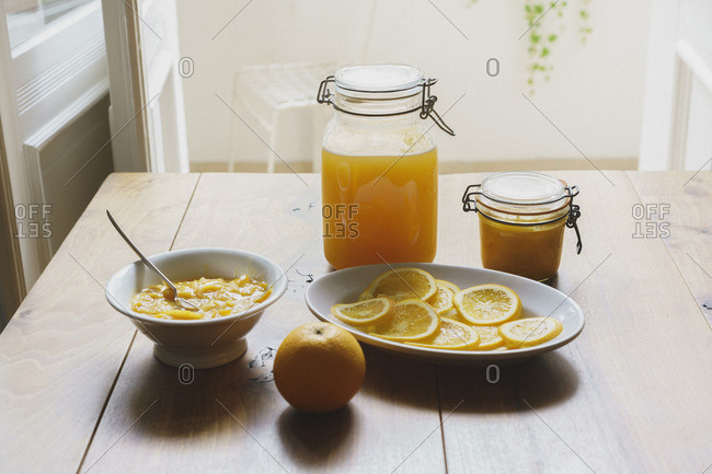 High angle view of citrus fruit sauces and preserves on table
