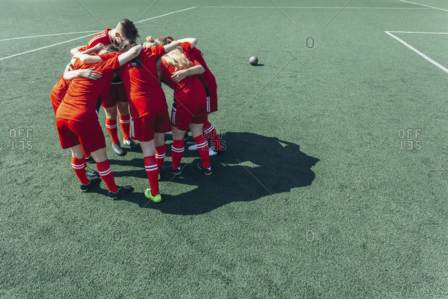 High angle view of soccer players huddling on field