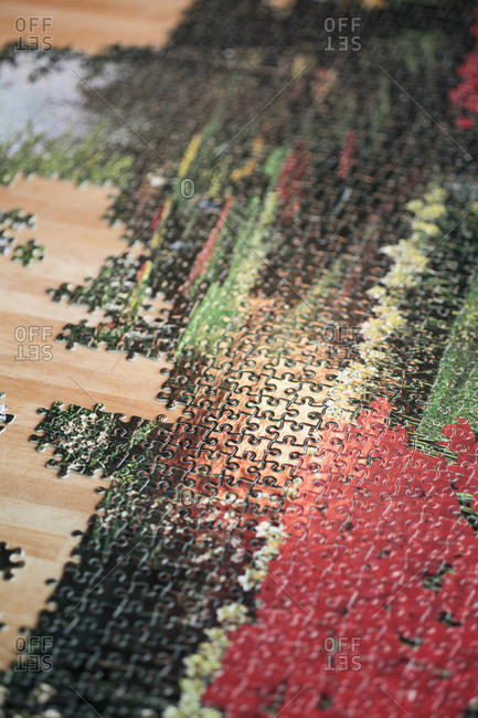 High angle view of incomplete jigsaw puzzle on wooden table