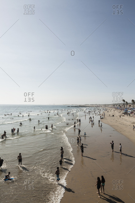 Newport Beach, California, USA - October 30 2016: High angle view of people on beach against clear sky
