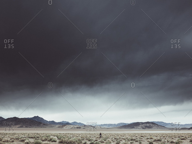 Scenic view of dramatic landscape against cloudy sky, Death Valley Road, California, USA