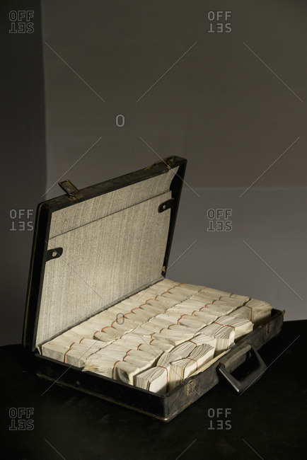 Bunch of envelopes arranged in briefcase on table