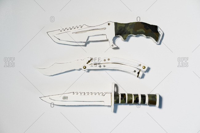 Directly above shot of paper knives on white background