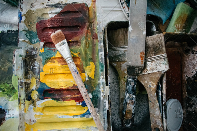 Close-up of paint brushes and color palette