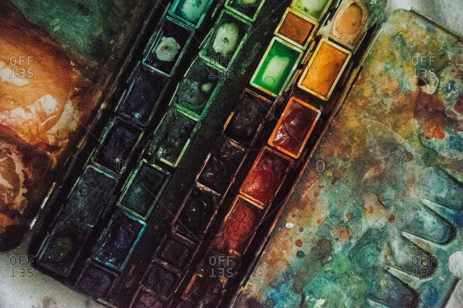 Overhead view of box of used watercolor paints