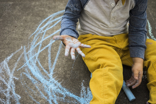 Boy's hand covered in chalk