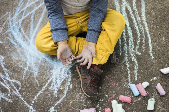 Boy with chalk covered hands