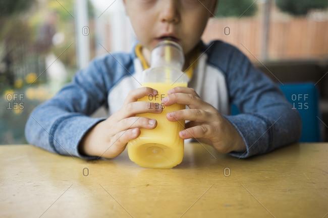 Boy drinking juice from a bottle