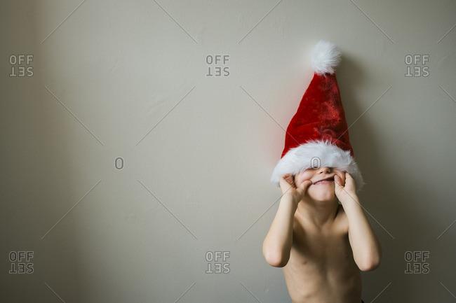 Boy being goofy in Santa hat