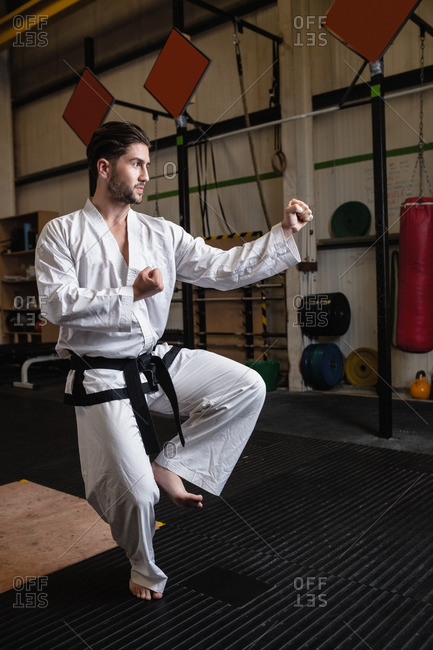 Man practicing karate in fitness studio