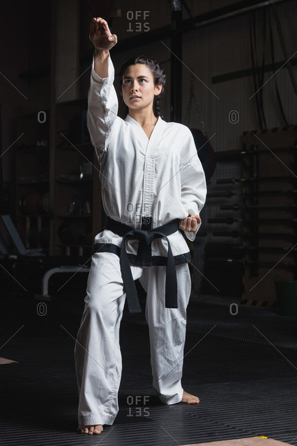 Woman practicing karate in fitness studio