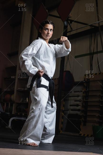 Woman practicing karate in fitness studio