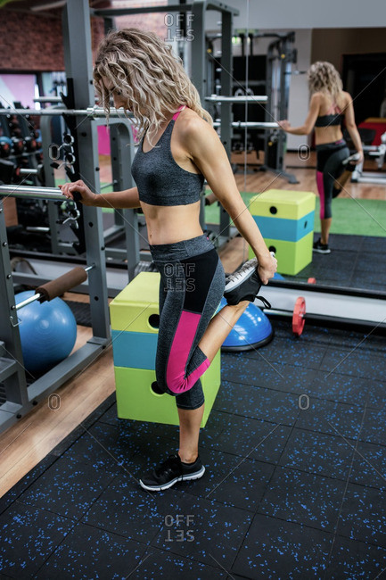 Woman performing exercise in gym