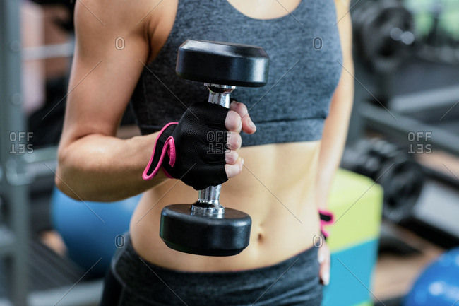 Woman lifting dumbbell at gym