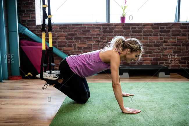 Woman working out with resistance band in gym