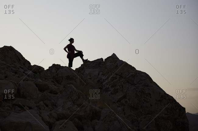 Nizwa, Oman - Woman on top of a hill