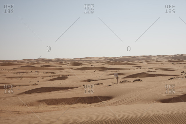 Wahiba sands, Oman  - January 10, 2016: Desert landscape with a sign
