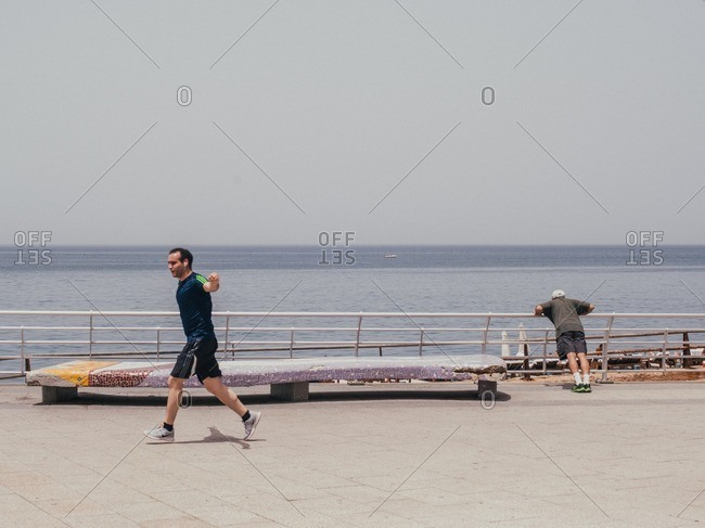 Beirut, Lebanon - May 14, 2016: Men working out along the Beirut Corniche