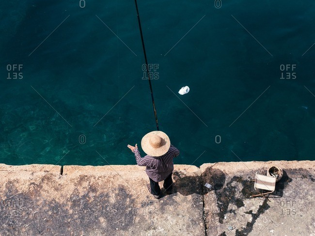 Man fishing on the shore of the Beirut Corniche in Beirut, Lebanon