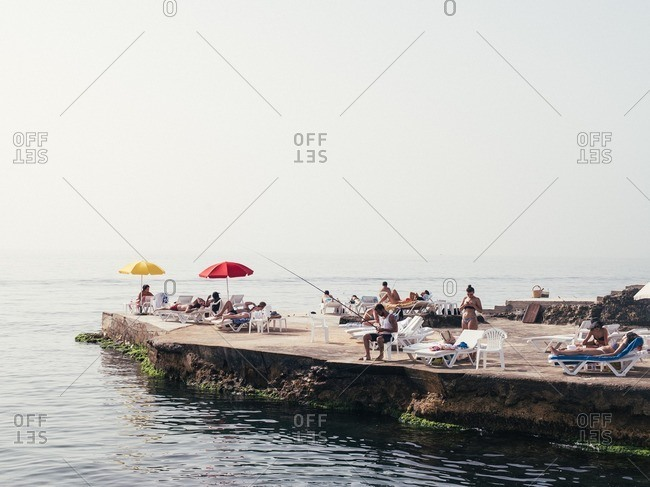 Beirut, Lebanon - May 14, 2016: People relaxing and fishing on the Beirut Corniche