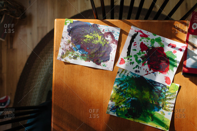 Finger paintings drying on a table