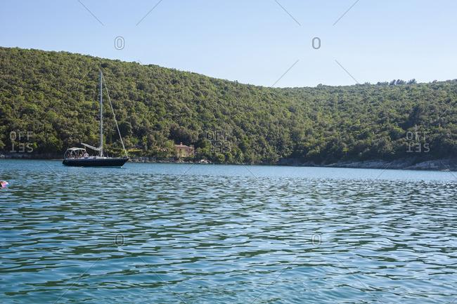 Pula, Croatia - June 17, 2012: Sailboat in the Adriatic Sea off the coast of Croatia