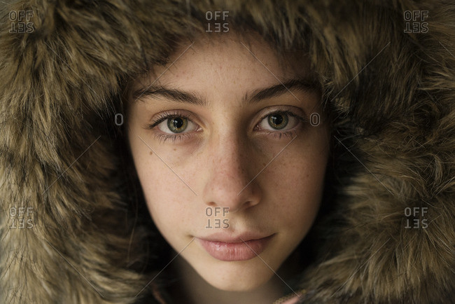 Beautiful young girl in a fur hood